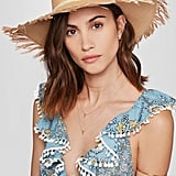 A wear-on-every vacation straw hat, like the Sensi Studio — Lady Majorca Frayed Toquilla Straw Hat — Sand ($150).