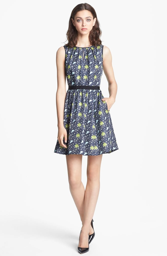 Work florals into your Fall wardrobe with the Packed Floral Print Dress ($395).