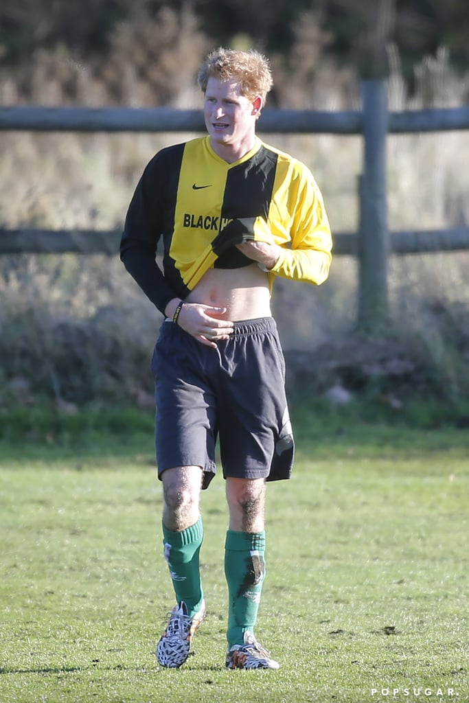 Prince Harry flashed his royal abs on Christmas Eve when he took part in a friendly soccer match in Castle Rising, Norfolk. The young royal showed off his athletic skills as he played alongside the Duchess of Cambridge's brother, James Middleton. Traditionally, Prince William also takes part in family's annual Christmas Eve match near Queen Elizabeth II's Sandringham Estate, where the royal family spends their holiday, though he wasn't present at this year's sporty match. However, he was on hand last year when Harry showed off his short-lived beard. Other royal family Christmas Eve traditions include gathering around the Christmas tree for last-minute decorations and opening presents. (The queen believes that the actual Christmas holiday itself should only be reserved for religion, not presents.) Tomorrow, on Christmas Day, Harry will be by his family's side as they make their annual trip to the Sandringham Estate's parish church.