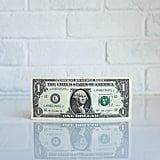 The dollar bill has several references to 13.