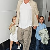 Brad Pitt took his twins Vivienne and Knox out in Tokyo after his World War Z premiere in Japan.