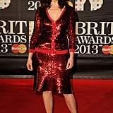 Gemma Arterton shimmered in a red sequined cardigan and matching skirt, both by Jonathan Saunders, at the 2013 Brit Awards.