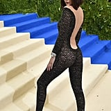 She accessorized the sheer outfit with a snake cuff on each arm and black heels.