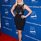 Reese Witherspoon (only a few short weeks postbaby!) showed off her stems in a lacy Elie Saab cocktail dress, which she finished with classic black pumps and a classic red lip.