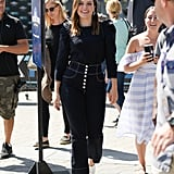 Sophia Bush's high-waist pants are the standout in this look. Follow her lead and you won't need much more than a T-shirt and mules to create a head-turning everyday look.