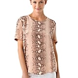 Score Miranda's exact Equipment silk snake-print tee ($168) to pair with everything from jeans to trousers to skirts.