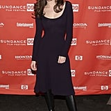 Emmy Rossum dressed down a femme, plum dress with flat boots in 2009.