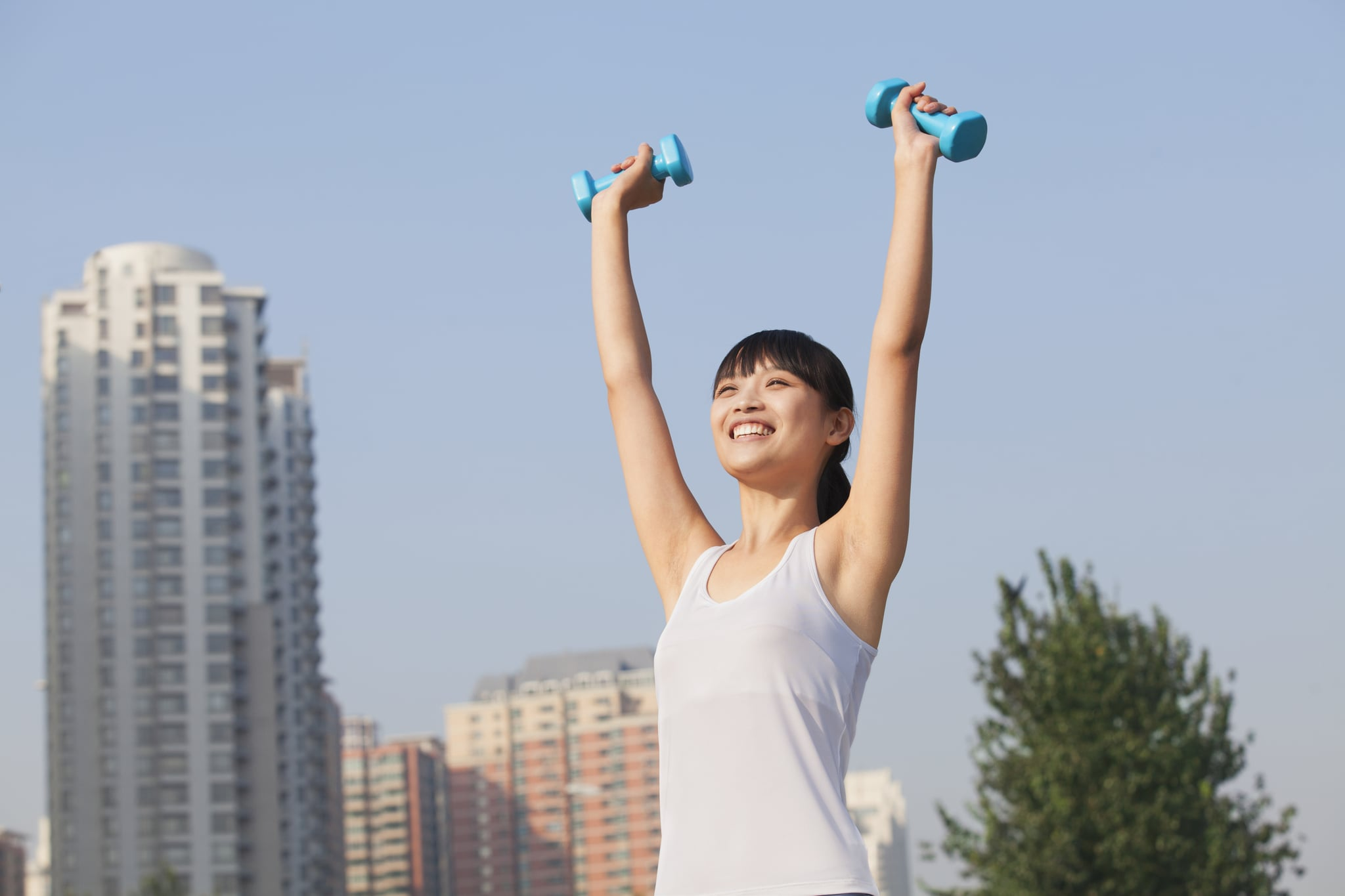 Chinese woman lifting dumbbells