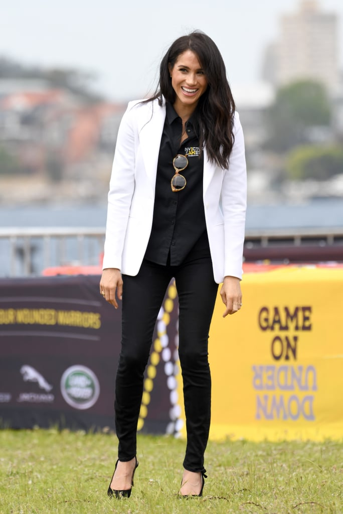 The Invictus Games hold a special place in Prince Harry and Meghan Markle's relationship, and the royals made their return as part of their 16-day South Pacfic tour. Meghan kept things casual for the occasion, and her taste in accessories quickly reminded us of her outfit for last year's games.  Harry and Meghan made their public debut as a couple during the 2017 Invictus Games, and we fell in love with their relationship and her laid-back look. Now, a whole year later at the Jaguar Land Rover Driving Challenge, Meghan proved that her picks are timeless — she can rock tortoiseshell sunglasses any day of the week. The Duchess of Sussex opted for an Illesteva pair ($240), which she teamed with a White Altuzarra blazer, Tabitha Simmons Millie Slingback Pointed Toe Pumps ($695), Mother Denim jeans ($196), Ecksand stackable rings, and of course, her Invictus Games button-up top. Check out more photos of her full outfit ahead, including some up-close snaps of her classic and sophisticated shades.       Related:                                                                                                           See Ya, Shoes! Meghan Markle Is a Barefoot Babe on the Beach in This Striped Maxi Dress
