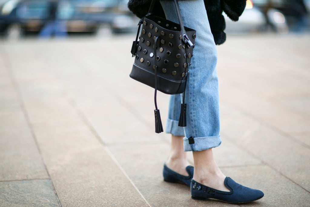 Chiara Ferragni's studded bag and navy loafers did their part to dress up her denim.