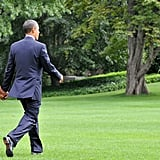 The Obamas held hands as they headed to the helicopter that would take them to New York City.