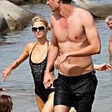 Paris Hilton and her mystery man spent an afternoon in and out of the water on Cavallo Island.