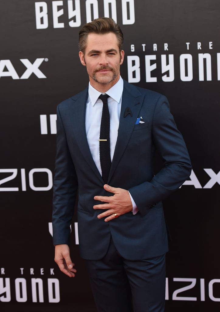 """Chris Pine continued his press tour for Star Trek Beyond on Wednesday, and his latest stop brought him to San Diego for the movie's premiere. Clad in yet another blue suit, Chris showed off his well-groomed scruff as he posed for photos and later linked up with his costars Karl Urban and John Cho, the latter of whom plays Hikaru Sulu, the film's first gay main character. Most recently, George Takei, the actor who portrayed Hikaru in the original series, revealed he wasn't very happy with this decision, telling The Hollywood Reporter, """"I'm delighted that there's a gay character. Unfortunately, it's a twisting of Gene [Roddenberry]'s creation, to which he put in so much thought. I think it's really unfortunate."""" Keep reading to see more photos from the night, then check out the final trailer for Star Trek Beyond."""