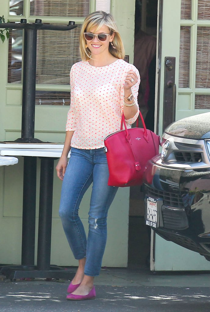 Witherspoon was a vision in pink donning a polka-dot Anthropologie blouse, suede flats, and a brilliant Louis Vuitton tote in Santa Monica.