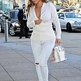 Kim wore white jeans.