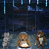 The Sochi bear stood beside the Olympic cauldron.