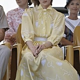 During a tour of Australia in 1983, Diana wore a yellow silk tea dress by Jan Van Velden.
