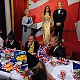 The wax figurines of the queen with Will and Kate looked on as kids celebrated the Jubilee.
