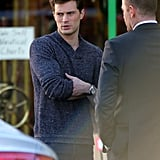 Dornan showed off Christian Grey's smoldering looks and thick arms.