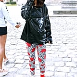 Just outside the Balenciaga show, singer M.I.A. made sure to stand out in a pair of wild jeans featuring a leopard and rose print, then added a patent anorak and bright red booties to match.