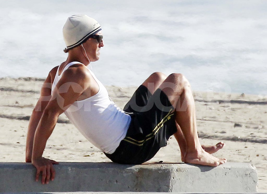 Matthew McConaughey hit the beach in Santa Monica for a very public workout yesterday. He broke a sweat jogging in the sand, then moved on for a round of sit-ups, push-ups, and stretching. MM didn't seem to mind doing his routine in front of other sunbathers, though unfortunately he didn't go shirtless. Matthew did, though, bare his abs while on a jog in Malibu over the weekend. He also took a trip with Levi and Vida down to the water, where the trio played together with their dog. Matthew's time outdoors means that he'll have the perfect glow when he starts promoting The Lincoln Lawyer ahead of its March release, and until then you can take a look at the fit actor in the dramatic trailer.