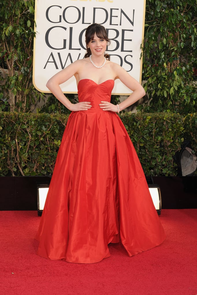 Zooey Deschanel posed in Oscar de la Renta on the Golden Globes red carpet.