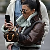 This is pretty much Kourtney's all-purpose mini purse. She rocked it with a cropped Balenciaga shearling jacket and plaid pants for an ice skating jaunt with family in Central Park.