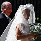 Zara Phillips is walked in with her beaming father, Mark Phillips.