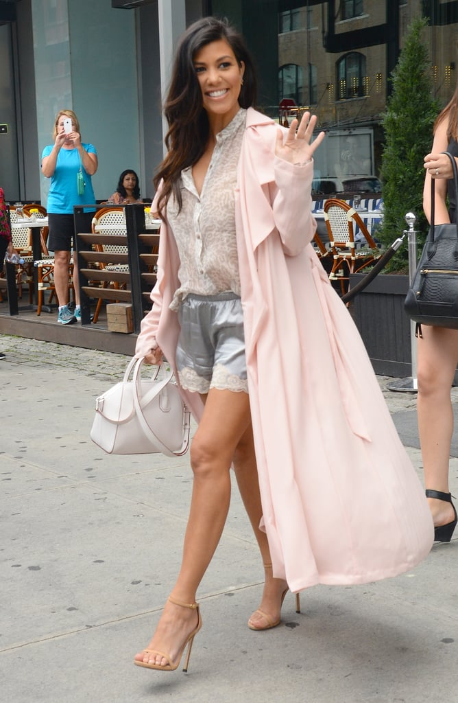 Kourtney Kardashian showed off her cape in NYC on Thursday, but hid her baby bump.