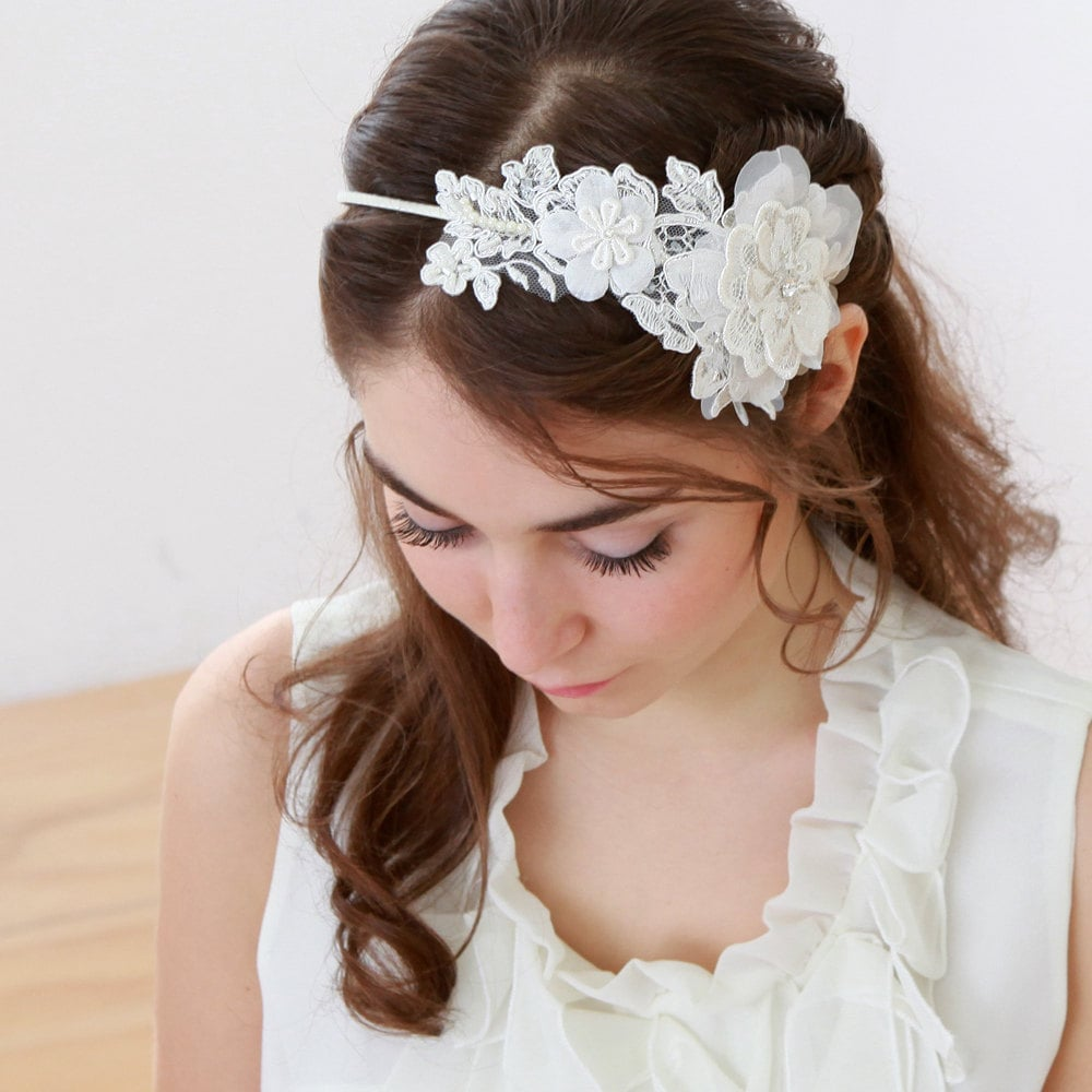A lace headband ($40) can make for a dramatic statement that's still graceful.