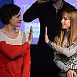 Elisabeth Moss gave a high-five to Holly Hunter at the 2013 Sundance Film Festival on Monday.