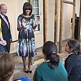 While visiting a classroom in Fairfax, VA, the first lady selected a polished and printed fit-and-flare Tracy Feith sheath and a pair of classic pumps.