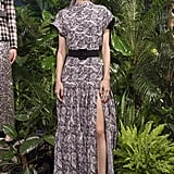 This maxi dress also is a design that we would love to see Meghan wear. While the high slit might be a bit risky, the high neck gives it a more demure look.