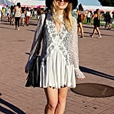 A long-sleeved lace dress isn't what you expect to see on a near-90-degree day, but this festivalgoer was completely comfortable in her Free People look.