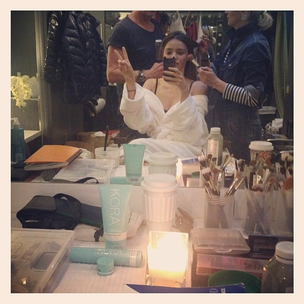 Miranda Kerr flashed a peace sign while getting her hair and makeup done. Source: Instagram user mirandakerr