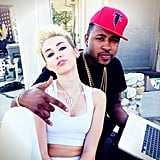 Miley Cyrus sat with producer Mike Will. Source: Twitter user mileycyrus
