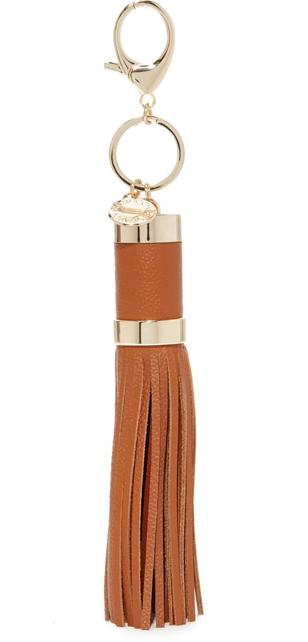 """""""While this Rebecca Minkoff Power Tassel Bag Charm ($55) would make a great stocking stuffer, I don't think I — or my constantly dying phone! — can wait that long. Adding it to my cart and clipping it on my bag, ASAP!"""" — SS"""