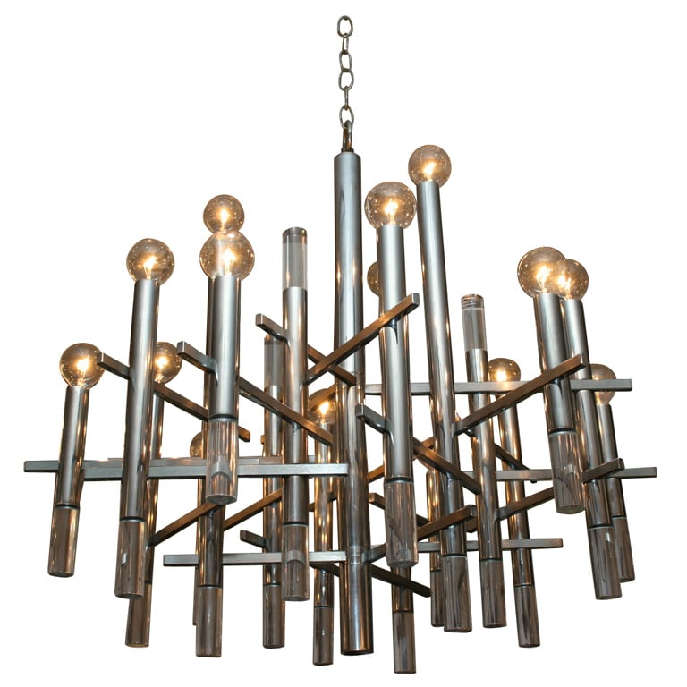 Maltby's chandelier is most likely a '70s Italian design by Gaetano Sciolari. Find a Sciolari Chandelier ($6,350) at 1st Dibs.