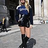 Romee Strijd Wore a Versace Sweater With a Black Mini Skirt to the Elie Saab Show