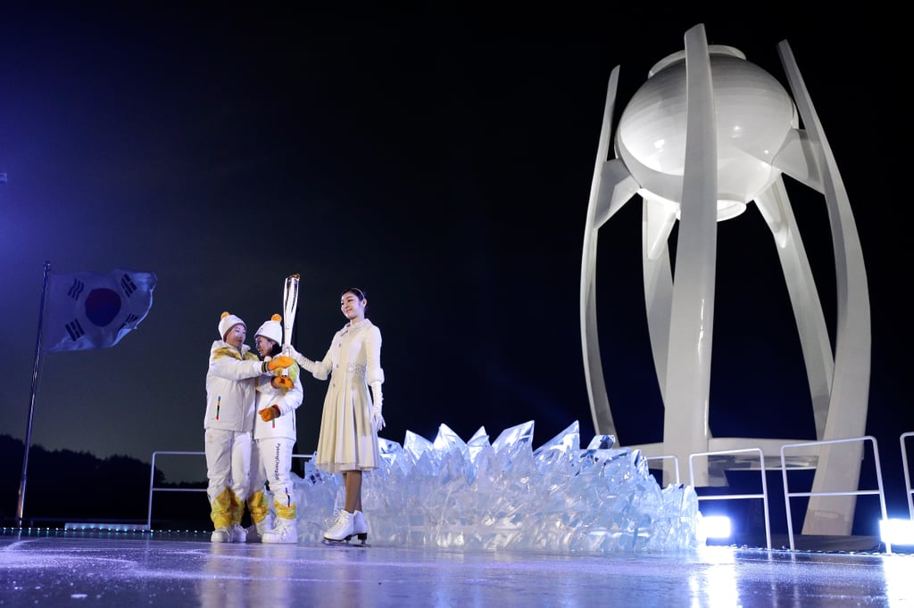The torch was handed off to South Korean figure skater Yuna Kim.