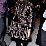Olivia proved that black and brown make a friendly duo in a chocolate fur coat and black suede boots at Dennis Basso in New York.