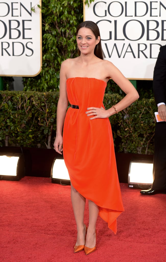 Marion Cotillard, mom to 1-year-old Marcel, heated things up in a red, asymmetrical Christian Dior gown.