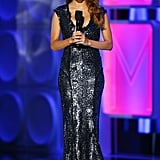 The actress spoke to the Alma Awards crowd wearing another embellished gown with cap sleeves and a plunging neckline. This one revealed her figure beautifully.