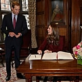 Kate Middleton and Prince Williams were all smiles as she signed the guest book.