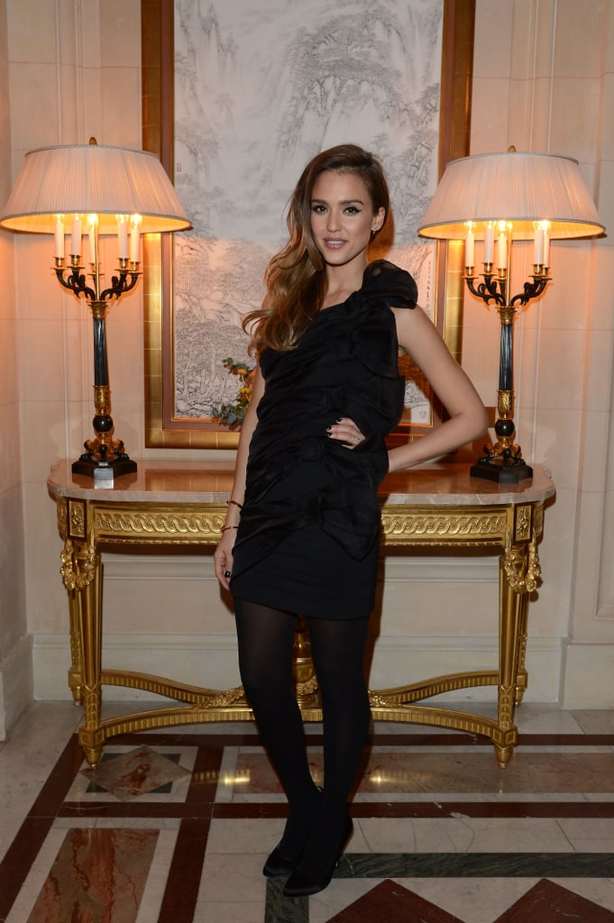 Jessica Alba wore a short black dress to the CR Fashion Book launch party.