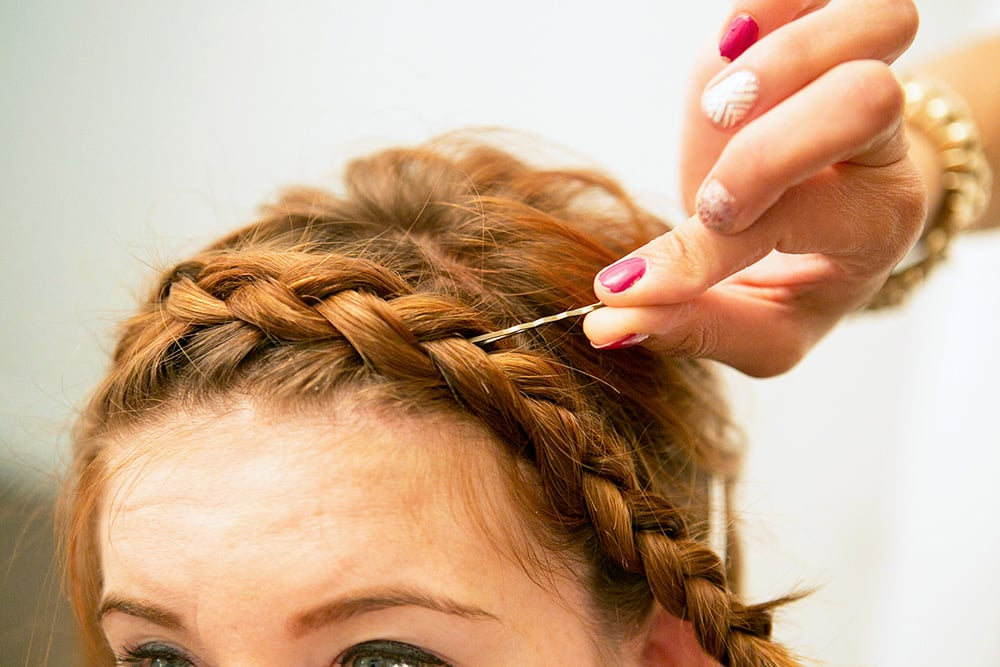 Huffnagle likes to use the end of a bobby pin to tuck stray hairs into your braid for a clean look.