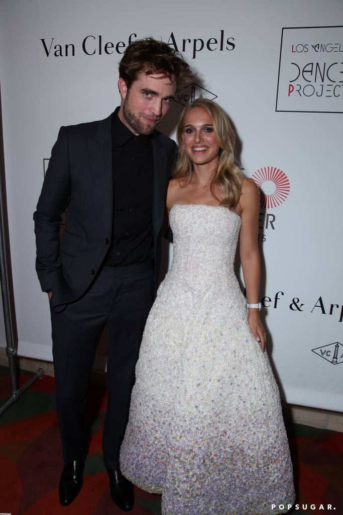 All eyes were on Natalie Portman and her platinum locks at Saturday night's Van Cleef & Arpels Dinner for LA Dance Project in LA. She stepped out in a floor-length, white Dior gown, and once inside, posed for photos with another famous face, Robert Pattinson. Natalie dined with husband Benjamin Millepied while Rob was reportedly in high spirits, enjoying the company of close friends. Kristen Stewart was noticeably absent; however, sources close to the couple say they're reportedly back together.