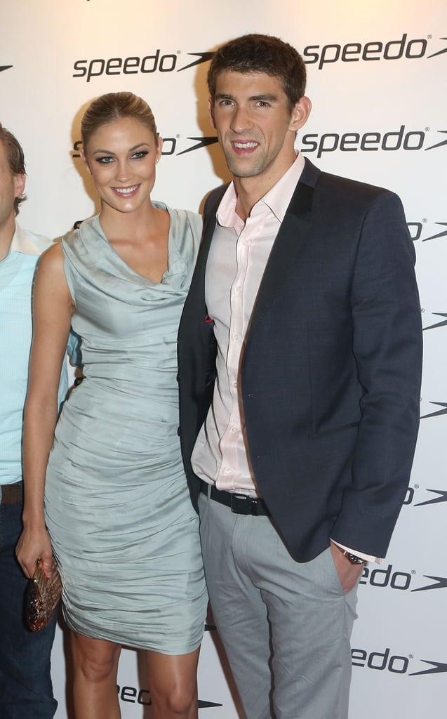 "Michael Phelps had girlfriend Megan Rossee on his arm to hit the red carpet at the Speedo Athlete Celebration in London on Monday evening. Michael's model love was catapulted into the spotlight over the weekend when he was spotted out partying in the England city with the leggy blonde and a few of his gold medals after completing his final Olympic event. Michael has been dating Megan, a 25-year-old model living in LA, for about five months, a fact her father confirmed. Megan accompanied Michael to London and has been tweeting about her experience, even using an affectionate pet name, ""bear,"" for Phelps.  Michael will be leaving London as the most decorated Olympian of all time, and up next for the superstar? According to his interview with Bob Costas, Michael is looking forward to downtime and sightseeing around the world. Perhaps he'll have Megan by his side. If they hit the beach, then perhaps we'll get a glimpse of those abs, which have already earned him a top-10 spot in our 2012 Shirtless Bracket so far — cast your votes now!"