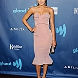 Glee girl Naya Rivera made a jaw-dropping appearance in a dusty pink strapless dress by Zac Posen paired with bold statement earrings and metallic pumps.