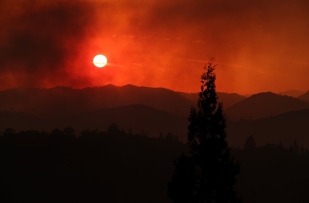 The sunset could be seen through a smoky sky in Groveland, CA.